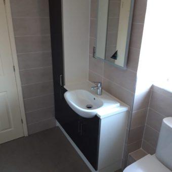 illuminated mirror & fitted furniture