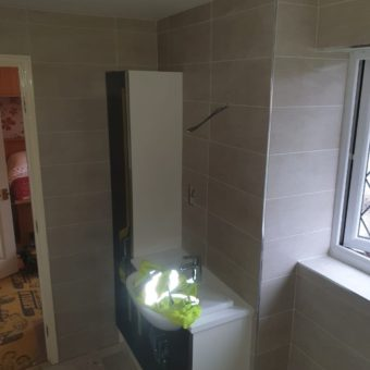 tiling around fitted furniture